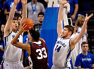 St. Louis  University basketball players Rob Loe (51) and Brian Conklin (14) apply defensive pressure to Fordham University's Chris Gaston (33) during the second half of the Billikens' 66-46 Atlantic 10 win over the Rams at Chaifetz Arena on the St. Louis University campus Saturday, Feb. 18, 2012 in St. Louis. Photo © copyright 2012 Sid Hastings.