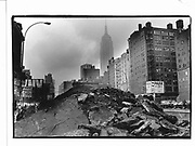 New York, Empire State building and road works© Copyright Photograph by Dafydd Jones 66 Stockwell Park Rd. London SW9 0DA Tel 020 7733 0108 www.dafjones.com