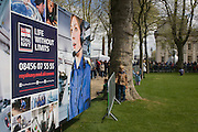A families queue, a Royal Navy careers recruitment trailer is parked in the grounds of the Naval College in Greenwich, London. During a public open-day in Greenwich, when the Royal Navy's aircraft carrier HMS Illustrious docked on the river Thames, allowing the tax-paying public to tour its decks before its decommisioning. Navy personnel helped with the PR event over the May weekend, historically the home of Britain's naval fleet.