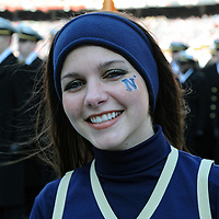 10 December 2011:   A Navy Midshipmen cheerleader takes the field prior to the game against the Army Black Knights at Fed Ex field in Landover, Md. in the 112th annual Army Navy game where Navy defeated Army, 27-21 for the 10th consecutive time.