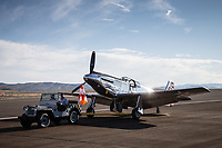RENO, NV - SEPTEMBER 13: A vintage Jeep pulls a vintage airplane onto the runway early in the morning for the Reno Championship Air Races on September 13, 2017 in Reno, Nevada. (Photo by Jonathan Devich/Getty Images)