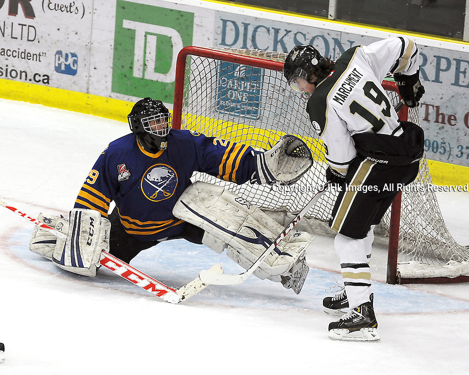 COBOURG, ON - Dec 23 : Ontario Junior Hockey League Game Action between the Cobourg Cougars and the Buffalo Jr. Sabres, Joseph Pianta #29 of the Buffalo Junior Sabres Hockey Club  protects the crease from Mason Marchment #19 of the Cobourg Cougars Hockey Club during second period game action.<br /> (Photo by Andy Corneau / OJHL Images)