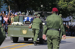 December 3, 2016 - Santiago De Cuba, CUB - After stalling along the road pass the Moncada Barracks, the Cuban honor guard push the military vehicle and trailer carrying the ashes of Fidel Castro, in Santiago de Cuba on Saturday, Dec. 3, 2016. (Credit Image: © Al Diaz/TNS via ZUMA Wire)