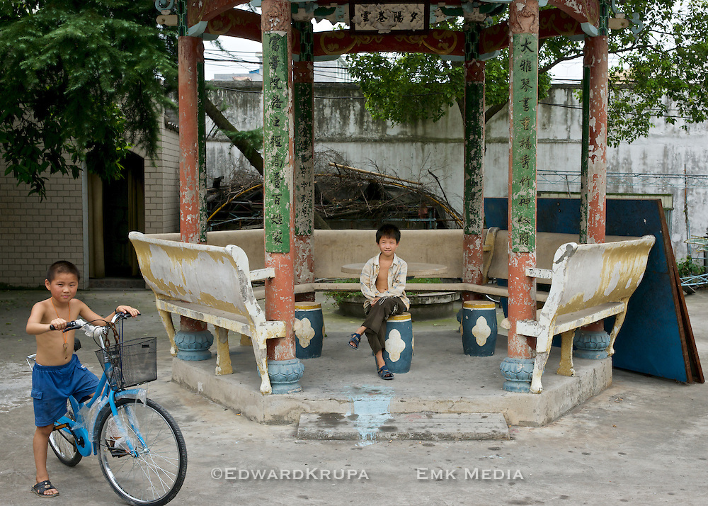 Two young boys in an old temple courtyard, Wenzhou, China.