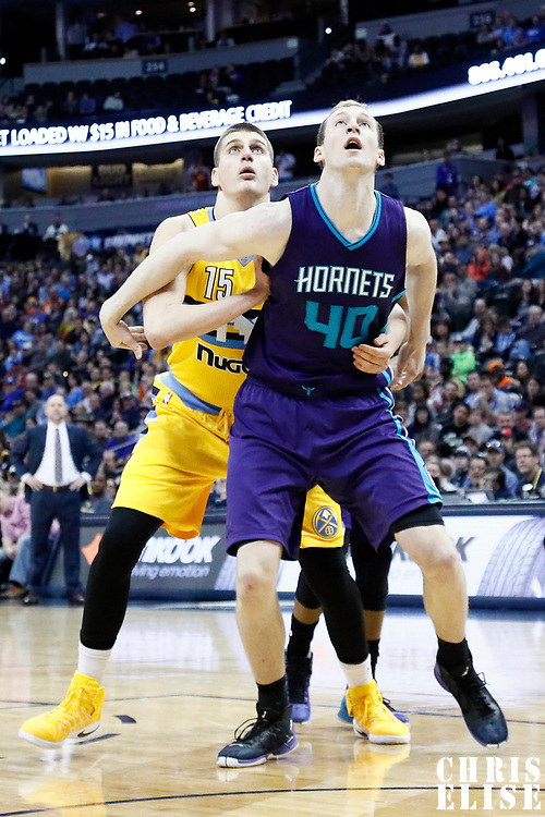 04 March 2017: Charlotte Hornets center Cody Zeller (40) vies for the rebound with Denver Nuggets forward Nikola Jokic (15) during the Charlotte Hornets 112-102 victory over the Denver Nuggets, at the Pepsi Center, Denver, Colorado, USA.