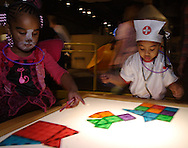 Tamia Manson, 4 (left) and Makiya Keeton of Dayton.during Howl-O-Ween 2010 at the Boonshoft Museum of Discovery in Dayton, Saturday, October 23, 2010..