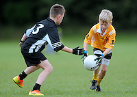 21 Aug 2016:  Action from the Boys U10 Boys Gaelic Football, Listowel, Co. Kerry (Black), v Clontibret, Co. Monaghan (yellow).  2016 Community Games National Festival 2016.  Athlone Institute of Technology, Athlone, Co. Westmeath. Picture: Caroline Quinn