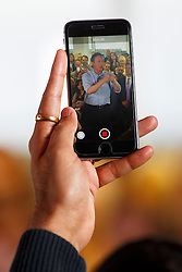 © Licensed to London News Pictures. 05/05/2015. LONDON, UK. A mobile phone filming Conservatives leader and Prime Minister David Cameron speaking to staff at Utility Warehouse in Hendon, northwest London on Tuesday, 5 May 2015. Photo credit : Tolga Akmen/LNP