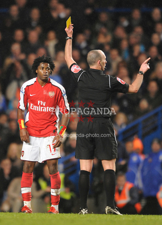 LONDON, ENGLAND - Sunday, February 7, 2010: Arsenal's Alex Song is shown the yellow card during the Premiership match at Stamford Bridge. (Photo by Chris Brunskill/Propaganda)