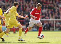 Photo: Leigh Quinnell.<br /> Nottingham Forest v Colchester United. Coca Cola League 1. 08/04/2006. Forests Kris Commons takes the ball past Colchesters Greg Halford.