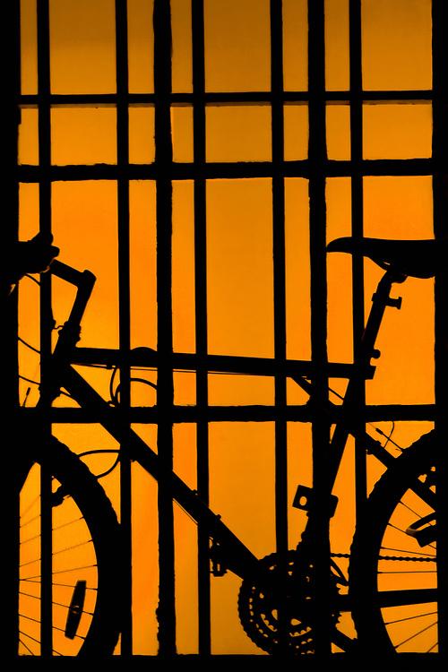 A bicycle on orange window