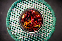 Naga chilis are jarred and pickled at a family home in Kohima, the capital of Nagaland state in northeastern India. The pickling process mellows their heat a bit, and helps preserve them.