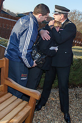 © Licensed to London News Pictures . 13/12/2012 . Hyde, Greater Manchester , UK . Tameside Division Chief Superintendent Nick Adderley comforts Sue Hughes (Nicola's mother) and Nicola's brother Sam Hughes . A memorial garden dedicated to PCs Fiona Bone and Nicola Hughes is opened at Hyde Police Station . The two officers were killed when responding to a routine call , earlier this year . Photo credit : Joel Goodman/LNP