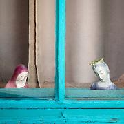 Religious icons showcase this southwest window found in Mesilla, New Mexico.