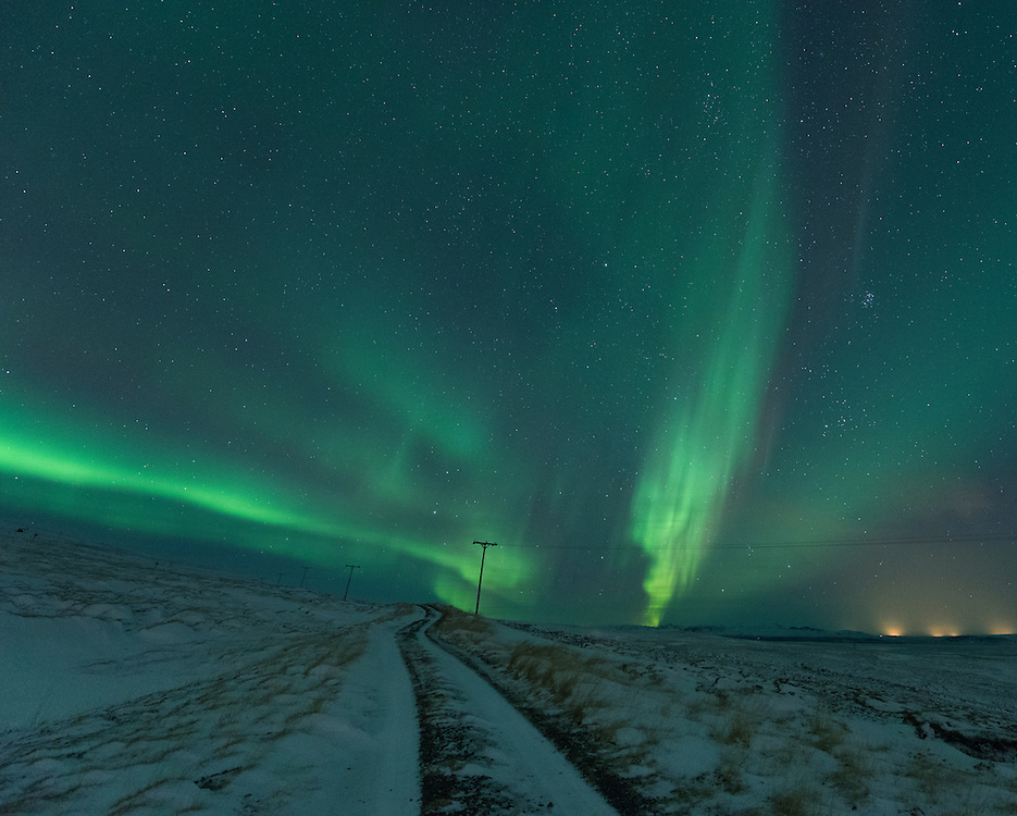 Aurora Borealis over a mountain road