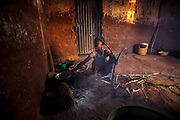 Shadya Jumanne, age 11 Ester Hodari&rsquo;s sister-in-law helps Ester cook. They are using a traditional cookstove.           Ester Hodari, age 22 years old, cooks dinner using the traditional three-rock cook stove with a fire in the middle. These cookstoves use a lot of fuel, firewood, and produce a lot of smoke. Ester told us that cooking with this type of stove made her eyes turn red and she often had a chest cough. Her children, ages 5, 2 and 3 months are often with her when she is cooking. Her sister-in-law, Shadya Jumanne, age 11, helps her cook as well. Not long ago Ester&rsquo;s 3 month-old developed a cough, It kept getting worse and so they took her by motorcycle to the hospital at night. Ester started really worrying about this.  After this Ester and her husband agreed that they needed to buy a clean cookstove and started saving. The girl helping Ester cook in some of the images is her sister-in-law Shadya Jumanne, age 11.<br /> <br /> Ester met Solar Sister entrepreneur Fatma Mziray when she married her husband and moved to this village, Mforo near Moshi, Tanzania. Ester said that Fatma is like a mother to her in the village. When Fatma showed Ester the new wood stove she saw that is used less wood and produced less smoke.