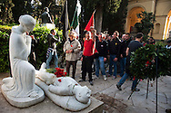 Roma 21 Aprile 2012.Gli Antifascisti in corteo,al quartiere San Lorenzo, portano un omaggio floreale al monumento dei caduti nella lotta per la liberazione al nazifascismo al cimitero del Verano ..Rome April 21, 20127..Anti-Fascists in the parade carrying a wreath at the monument of the fallen in the struggle for the liberation of Nazi-fascism in the Verano cemetery.
