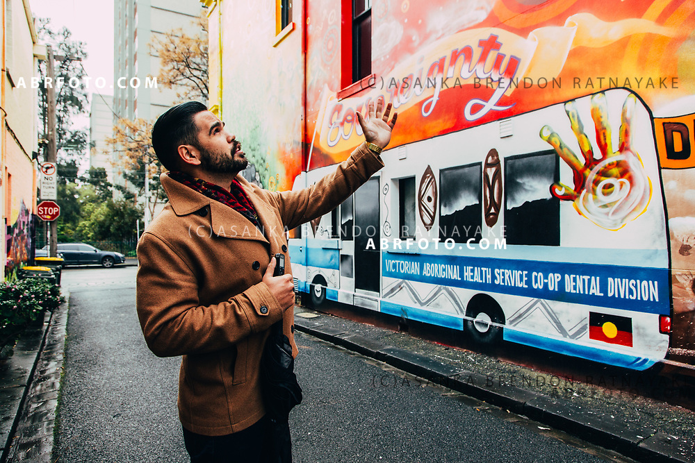 Aboriginal artist Robert Young stands in front of his mural painted alongside the Charcoal Lane restaurant on Gertrude Street Melbourne, Australia, August 30, 2017. <br /> The mural pays homage to the importance of Gertrude Street to Aboriginal people. Asanka Brendon Ratnayake for the New York Times