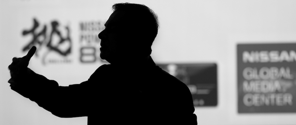 CEO Carlos Ghosn silhouette while addressing the staff of MARCOM at Nissan GHQ.