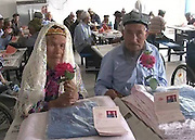 71-year-old man marries 114-year-old bride!<br /> <br /> According to reports, Kashi Bachu a 71-year-old man with a 114-year-old Granny marriage. Two elderly people in a nursing home is met, the old man hard in pursuit of one year finally do so. Finally, the two went to the local civil affairs department took out a marriage license and go through the wedding. She had the old man feel good cooking and attentive kind, then started fierce pursuit, and it was rejected during the times. Today, the two old finally tie the knot in a nursing home and the wedding was held. Two elderly people at the wedding, is delighted to see the face.<br /> Exclusivepix Media