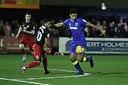 Coventry City defender Dion Kelly-Evans (30) and AFC Wimbledon striker Lyle Taylor (33) in action during the EFL Sky Bet League 1 match between AFC Wimbledon and Coventry City at the Cherry Red Records Stadium, Kingston, England on 14 February 2017. Photo by Stuart Butcher.