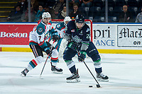 KELOWNA, CANADA - JANUARY 5: Libor Zabransky #7 of the Kelowna Rockets back checks Nolan Volcan #26 of the Seattle Thunderbirds during first period on January 5, 2017 at Prospera Place in Kelowna, British Columbia, Canada.  (Photo by Marissa Baecker/Shoot the Breeze)  *** Local Caption ***