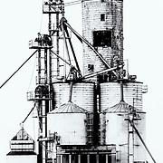 Grain silos in monochrome<br /> lines leading to left