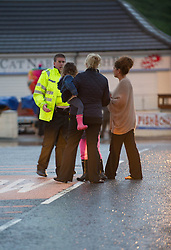 © Licensed to London News Pictures. 06/09/2013<br /> <br /> Saltburn, Cleveland, England<br /> <br /> A family is directed by a policeman as they stand on a bridge near Cat Nab car park as heavy flooding hits in Saltburn in Cleveland.<br /> <br /> Photo credit : Ian Forsyth/LNP