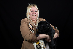 © Licensed to London News Pictures. 10/03/2016. Birmingham, UK. Jacqoline Howe with her Pug named Axel at Crufts 2016 held at the NEC in Birmingham, West Midlands, UK. The world's largest dog show, Crufts is this year celebrating it's 125th anniversary. The annual event is organised and hosted by the Kennel Club and has been running since 1891. Photo credit : Ian Hinchliffe/LNP