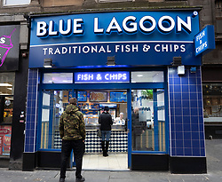 Glasgow, Scotland, UK. 26 March, 2020. Views from city centre in Glasgow on Thursday during the third day of the Government sanctioned Covid-19 lockdown. The city is largely deserted. Only food and convenience stores open. Pictured; Blue Lagoon fish and chip shop stayed open. Iain Masterton/Alamy Live News