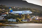 Thomas Cook Condor jet airplane tourist charter flight pilot flying into Kerkyra, Corfu Town, ready for landing, Ionian Islands, Greece