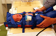 Michael Grabinski, two weeks old is immobilized in an inflatable jacket before going into a MRI machine at The Children's Hospital in Aurora, Colorado August 23, 2010 during a research study on obesity in infants. The overall theme of the study is to understand the continuum of growth that starts really at conception, and to understand if the earliest phases of growth impacts later risk for obesity.    REUTERS/Rick Wilking (UNITED STATES)