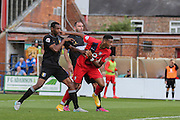 York City forward Vadaine Oliver gets a header goalwards  during the Sky Bet League 2 match between York City and Mansfield Town at Bootham Crescent, York, England on 29 August 2015. Photo by Simon Davies.