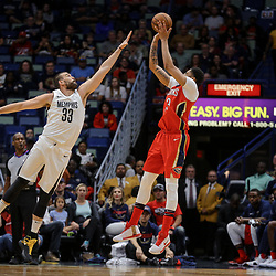 Apr 4, 2018; New Orleans, LA, USA; New Orleans Pelicans forward Anthony Davis (23) shoots over Memphis Grizzlies center Marc Gasol (33) during the first quarter at the Smoothie King Center. Mandatory Credit: Derick E. Hingle-USA TODAY Sports