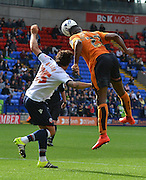 Ethan Ebanks-Landell outumps Lawrie Wilson during the Sky Bet Championship match between Bolton Wanderers and Wolverhampton Wanderers at the Macron Stadium, Bolton, England on 12 September 2015. Photo by Mark Pollitt.