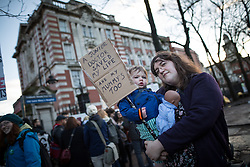 "© Licensed to London News Pictures . 12/01/2016 . Manchester , UK . A boy holding a placard reading "" A Junior Doctor saved my life and my mummy's too "" at a picket outside the Manchester Royal Infirmary in England as the first of three planned strikes by Junior Doctors over pay and working conditions starts this morning (12th January 2016) at 8am . Photo credit : Joel Goodman/LNP"