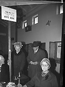 President Eamon de Valera and An Taoiseach Seán Lemass cast their votes in the General Election. Picture shows Mrs. Lemass voting at Churchtown Schools, Dublin, watched by her husband.  <br /> 07.04.1965