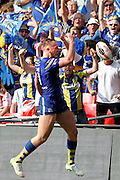 Ben Currie throws the ball to the Warrington fans after scoring his try during the Challenge Cup Final 2016 match between Warrington Wolves and Hull FC at Wembley Stadium, London, England on 27 August 2016. Photo by Craig Galloway.