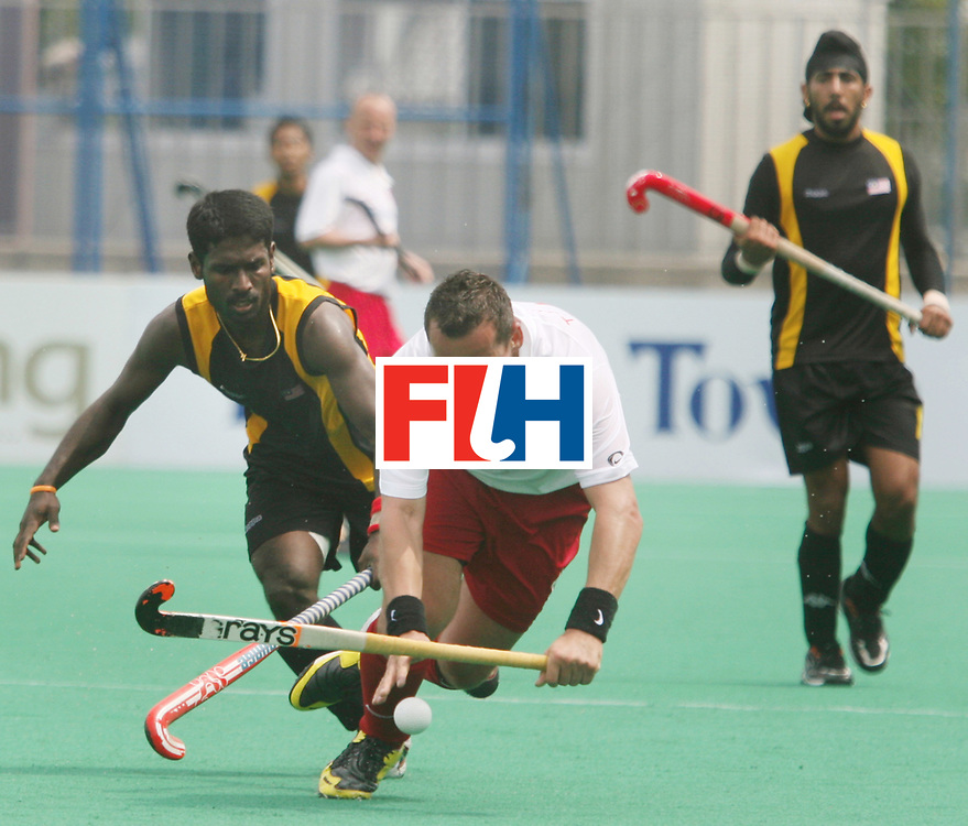 Kakamigahara (Japan): Selvaraju of Malaysia and Miroslaw Juszczak of Poland fight for the ball in the Olympic Hockey Qualifier at Gifu Perfectural Green Stadium at Kakamigahara on 13 April 2008. Malaysia beat Poland 3-0.<br />  Photo: GNN/ Vino John