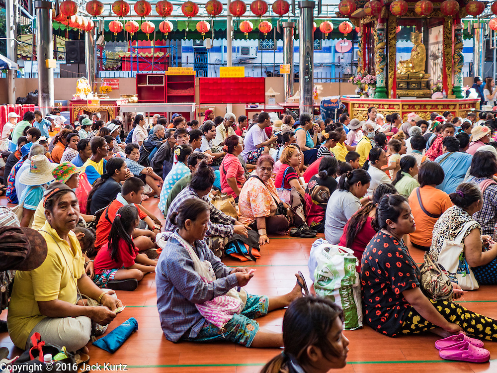 30 AUGUST 2016 - BANGKOK, THAILAND: People wait for their turn to get food and clothing at the Poh Teck Tung Shrine in Bangkok on the last day Hungry Ghost Month. Chinese temples and shrines in the Thai capital host food distribution events during Hungry Ghost Month, during the 7th lunar month, which is usually August in the Gregorian calendar.          PHOTO BY JACK KURTZ        PHOTO BY JACK KURTZ