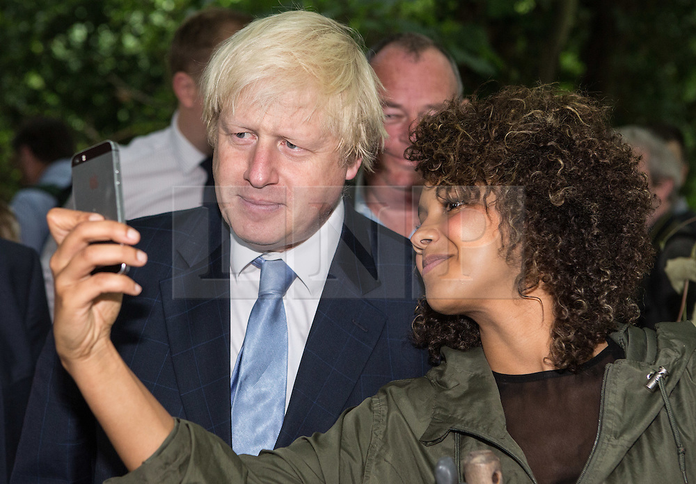 © Licensed to London News Pictures. 30/07/2015. London, UK. The Mayor of London and MP for Uxbridge and South Ruislip Boris Johnson takes a selfie during a visit the Wide Horizons Environment Centre in Bexley where he explored their new outdoor learning centre which was built by an 'army of volunteers' on a once derelict site. Photo credit : James Gourley/LNP