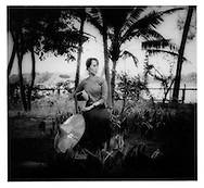 1996 Aung San Suu Kyi in the garden of her Rangoon home, Burma.  She is now under house arrest..