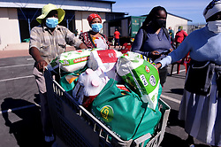 South Africa Cape Town 06 May 2020 Mfanelo Hlulukana with his grocery.Give of the Givers together with Nyanga SAPS donated food parcel to Nyanga senior citizens in Lusaka Hall Nyanga Photographer Ayanda Ndamane African news agency/ANA
