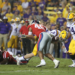 Sep 29, 2018; Baton Rouge, LA, USA; Mississippi Rebels linebacker Mohamed Sanogo (46) forces a fumble against the LSU Tigers during the second quarter of a game at Tiger Stadium. Mandatory Credit: Derick E. Hingle-USA TODAY Sports