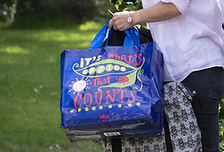 © Licensed to London News Pictures. 25/06/2016. Oxfordshire, UK. Marina Wheeler, wife of Boris Johnson, carries a Tesco bag with the words 'It's what's inside that counts' on as she is seen leaving their Oxfordshire home. Mr Johnson is spending the weekend away from London and Westminster. Photo credit: Peter Macdiarmid/LNP