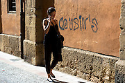 Spanish woman using cellphone in Calle Sacramento in Leon, Castilla y Leon, Spain