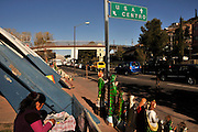 A woman in Nogales, Sonora, Mexico, sells religious items to those waiting in vehicles to enter the Dennis DeConcinni Port of Entry customs inspection station, which is located in Nogales, Arizona, USA.