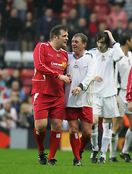 LIVERPOOL, ENGLAND - SUNDAY MARCH 27th 2005: Liverpool Legends' Jan Mølby and Kenny Dalglish after beating the Celebrity XI 6-2 during the Tsunami Soccer Aid match at Anfield. (Pic by David Rawcliffe/Propaganda)