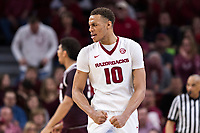 FAYETTEVILLE, AR - FEBRUARY 17:  Daniel Gafford #10 of the Arkansas Razorbacks flexes his muscles during a game against the Texas A&M Aggies at Bud Walton Arena on February 17, 2018 in Fayetteville, Arkansas.  The Razorbacks defeated the Aggies 94-75.(Photo by Wesley Hitt/Getty Images) *** Local Caption *** Daniel Gafford