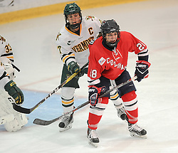 PITTSBURGH, PA - OCTOBER 15:  Amanda Pantaleo #28 of the Robert Morris Colonials battles in front with Taylor Willard #27 of the Vermont Catamounts in the first period during the game at 84 Lumber Arena on October 15, 2016 in Pittsburgh, Pennsylvania. (Photo by Justin Berl)